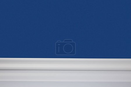 blue wall and white floor in apartment