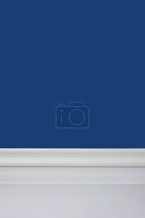 blue wall and white floor in room