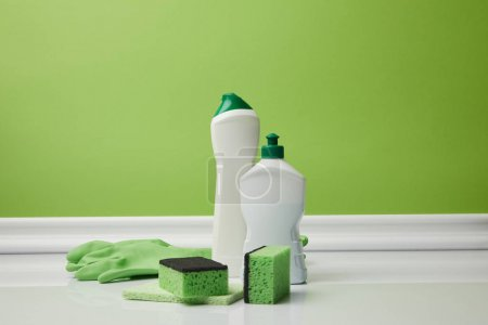 Photo for Bottles and washing sponges for spring cleaning - Royalty Free Image