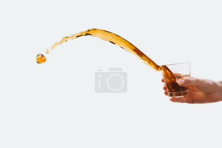 Photo for Aromatic coffee splashing from glass, isolated on white - Royalty Free Image