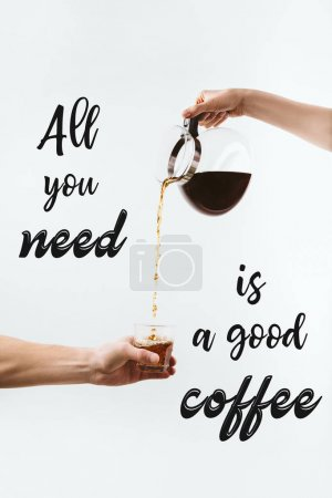 "Photo for Cropped view of hands pouring coffee from pot into glass, isolated on white with ""All you need is a good coffee"" inspiration - Royalty Free Image"