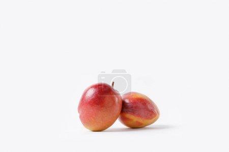 close up view of fresh mango fruits isolated on white