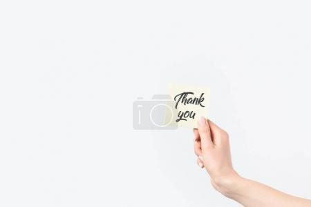 partial view of woman holding thank you card isolated on white