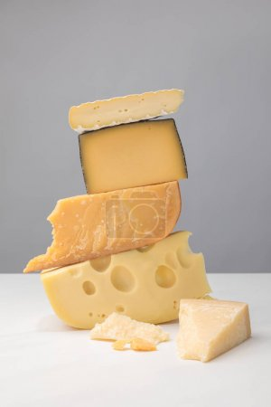 Photo for Close up view of stack of different types of cheese on gray - Royalty Free Image