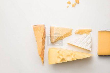 Photo pour Top view of different types of cheese on white - image libre de droit