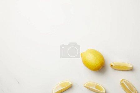 Ripe yellow whole fruit and slices of lemon isolated on white