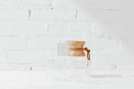 Closeup shot of empty glass mugs and chemex