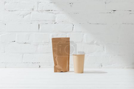 Photo for Front view of paper package of coffee and disposable cup - Royalty Free Image