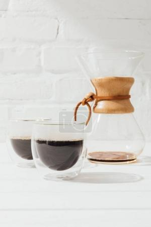 Photo for Closeup shot of alternative coffee in glass cups and chemex - Royalty Free Image