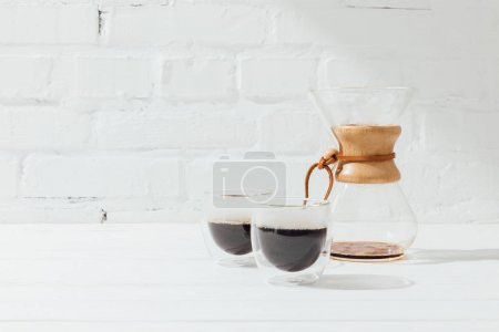 Two glass mugs with alternative coffee and chemex