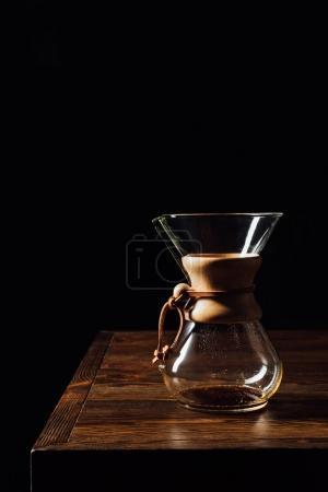 Alternative coffee in chemex on wooden table