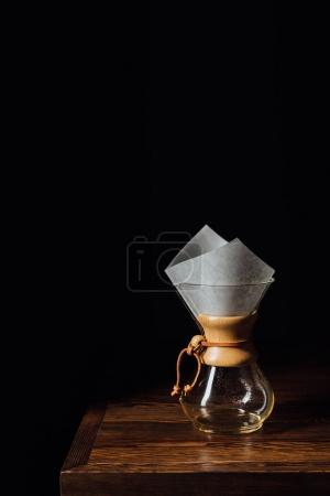 Photo for Alternative coffee in chemex with filter cone on wooden table - Royalty Free Image