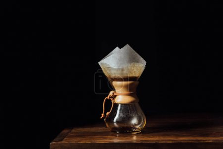 Alternative coffee in chemex with filter cone on wooden table