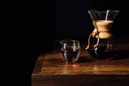 alternative coffee in chemex and glass mug on wooden table