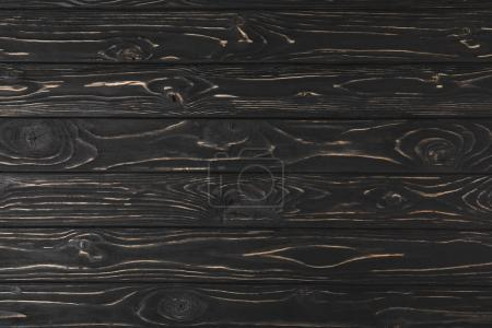 full frame image of dark rough wooden surface