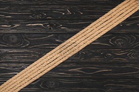 top view of brown nautical ropes placed in row on wooden surface