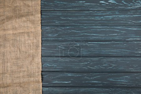 top view of sackcloth on wooden background