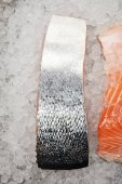 close-up shot of sliced salmon fillet on crushed ice