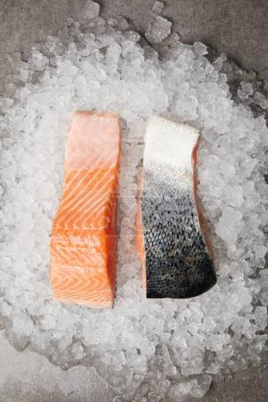 top view of sliced red fish fillet on crushed ice