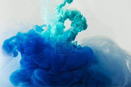 Photo for Close up view of mixing of blue and turquoise inks splashes in water isolated on gray - Royalty Free Image