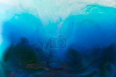 Photo for Full frame image of mixing of blue, turquoise and black paints splashes  in water - Royalty Free Image