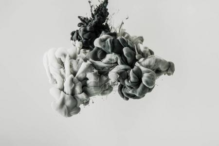 Photo for Close up view of mixing of light gray and black paints splashes in water isolated on gray - Royalty Free Image