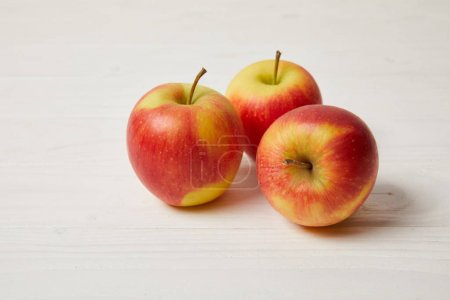 Photo for Raw organic apples on wooden surface - Royalty Free Image