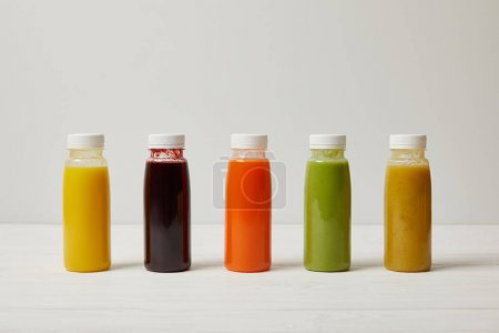 Photo for Detox smoothies in bottles standing in row, refresh concept - Royalty Free Image