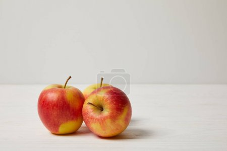 Photo for Raw fresh apples on wooden surface - Royalty Free Image