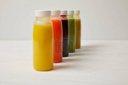 organic detox smoothies in bottles standing in row