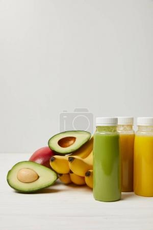 Photo for Fresh detox fruits and smoothies in bottles on white background - Royalty Free Image