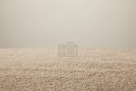 close up view of sand texture on grey backdrop