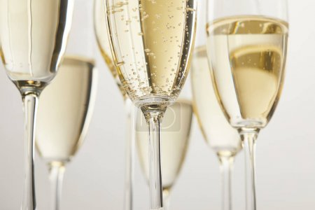 Photo for Cropped image of champagne glasses with bubbles isolated on white background - Royalty Free Image