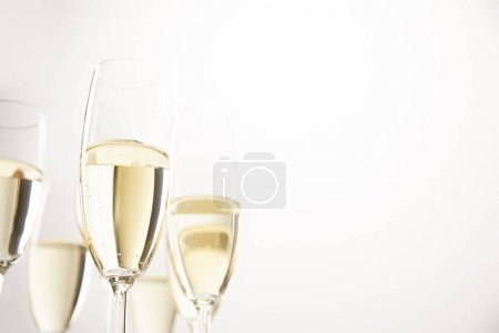 Photo for Closeup view of champagne glasses isolated on white background - Royalty Free Image