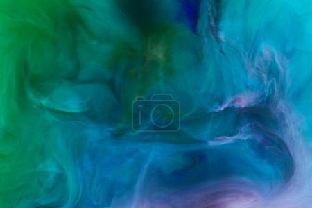 creative background with blue and green swirling paint