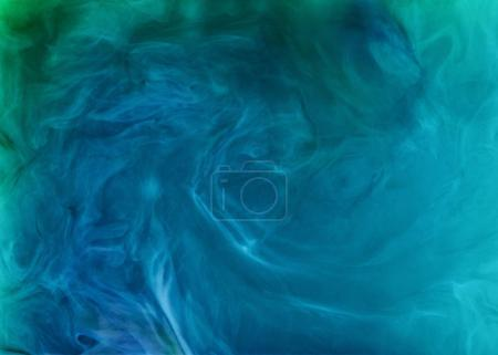creative background with blue flowing and swirling paint