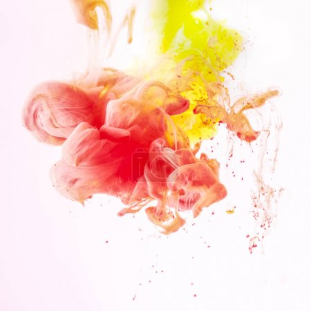 Photo for Splashes of smoky yellow and red paint, isolated on white - Royalty Free Image