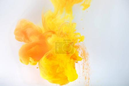 artistic background with flowing yellow and orange paint, isolated on grey