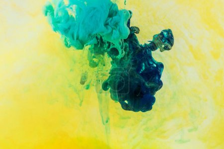 Photo for Background with green and turquoise paint flowing in yellow water - Royalty Free Image