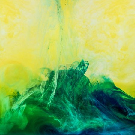 abstract background with swirls of green paint in yellow water