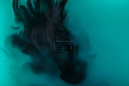 Photo for Smoky background with black paint in turquoise water - Royalty Free Image