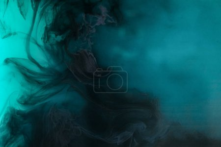 abstract background with black watercolor paint in turquoise water