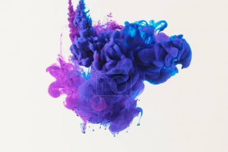 Photo for Abstract design with flowing blue and purple ink in water, isolated on white - Royalty Free Image