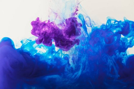 abstract texture with blue and purple paint flowing in water