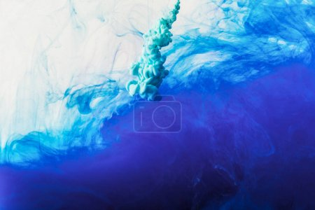 Photo for Abstract background with flowing blue and turquoise paint in water - Royalty Free Image