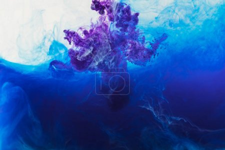 Photo for Abstract design with flowing blue and purple paint in water - Royalty Free Image