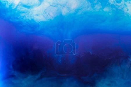 Photo for Abstract texture with blue watercolor paint flowing in water - Royalty Free Image