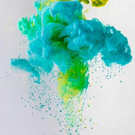 Photo for Design with flowing turquoise, blue and green paint in water with drops, isolated on grey - Royalty Free Image
