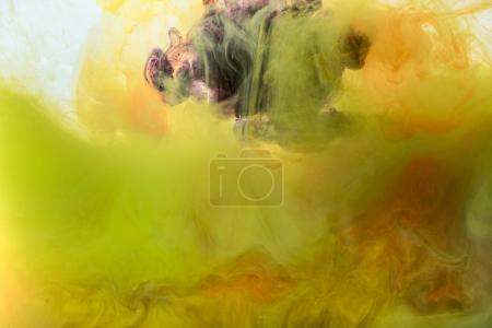 artistic background with flowing yellow, orange and purple paint