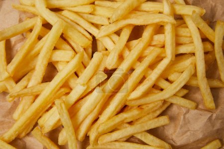 top view of french fries on crumpled paper